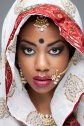 Indian woman in traditional clothing with bridal makeup