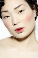 Korean model with very pale skin and bloody stain on lips.