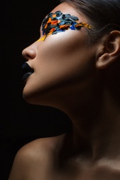 Portrait of the beautiful asian girl with creative art makeup with bright colors