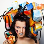 close-up portrait of beautiful young girl with cubes on head.