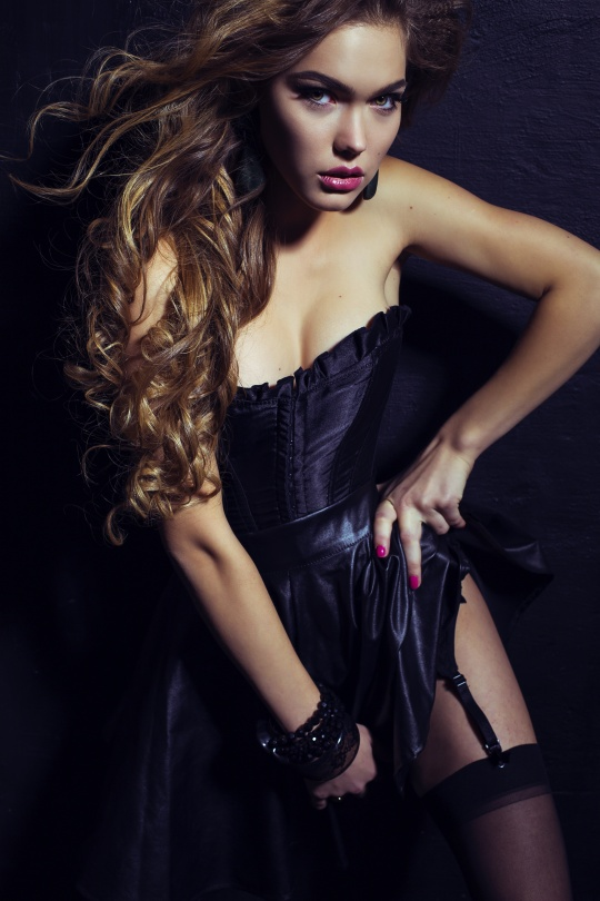 892667d59dd woman with long dark curly hair wears luxurious lingerie and ...