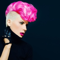 Sensual portrait lady with fashionable haircut colored hair on a